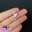 2 charms with pink ballerina