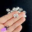 "5 heart charms with paw and the words ""best friend"""