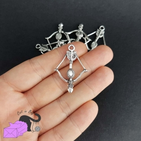 4 charms with bow and arrow